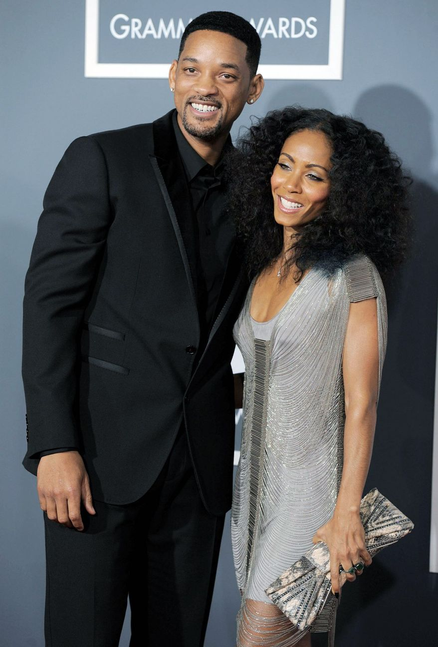 Will Smith and Jada Pinkett Smith deny tabloid reports that their 13-year-old marriage is coming to an end. (Associated Press)