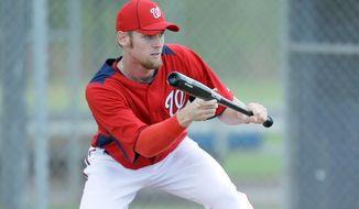 Stephen Strasburg, shown during spring training, took batting practice and threw a bullpen session Wednesday at Nationals Park. (Associated Press) ** FILE **