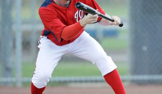 Stephen Strasburg, shown during spring training, took batting practice and threw a bullpen session Wednesday at Nationals Park. (Associated Press)
