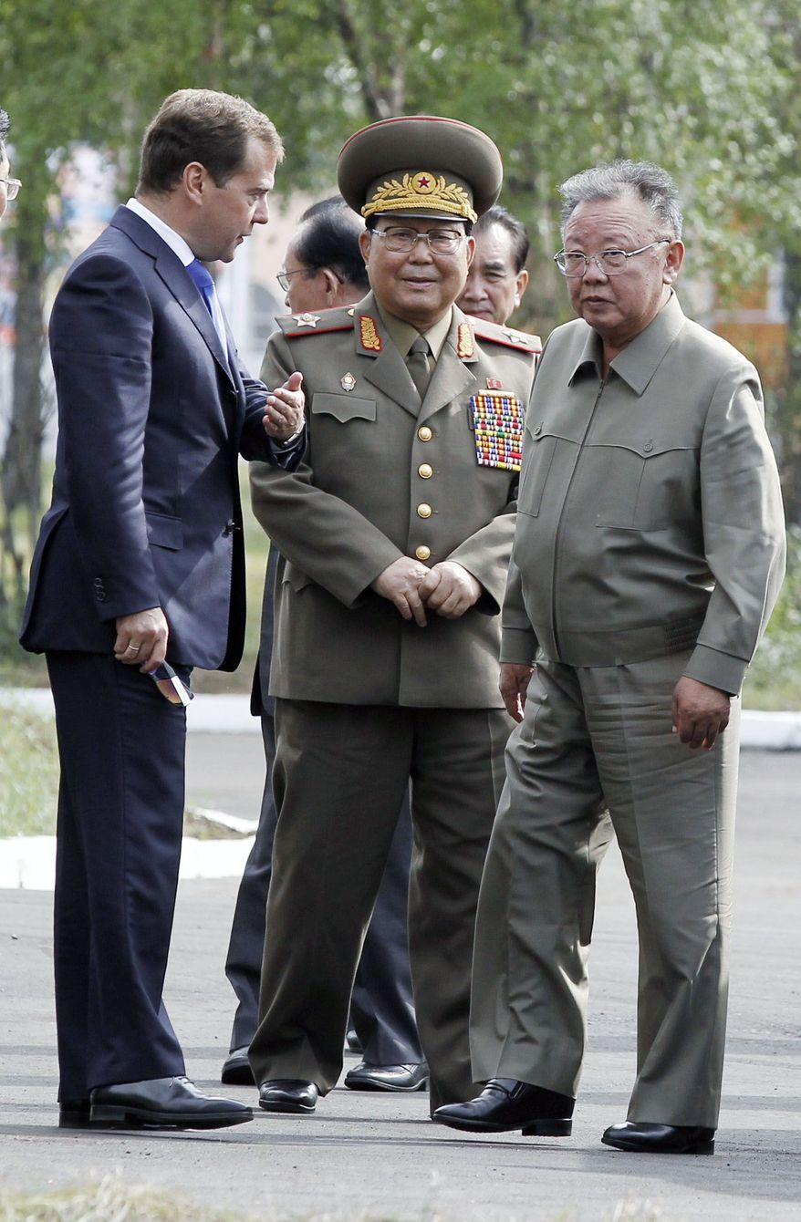 North Korean leader Kim Jong-il (right) is greeted by Russian President Dmitry Medvedev on Wednesday at a military garrison near the city of Ulan-Ude in Buryatia, a predominantly Buddhist province near Lake Baikal, Russia. (Associated Press)