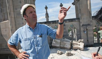 Mason foreman Joe Alonso explains Aug. 24, 2011, how much damage was done to the center tower at the National Cathedral during a 5.8-magnitude earthquake the day prior. (Andrew S. Geraci/The Washington Times)