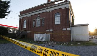 The sun sets behind a damaged building in Mineral, Va., a small town close to the epicenter of 5.8-magnitude earthquake that struck the East Coast on Aug. 23, 2011. (Associated Press)