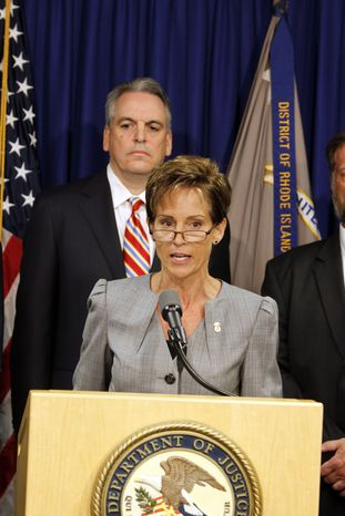 Kathleen Martin-Weis, acting director of the FDA office of criminal investigations, and Peter Neronha, U.S. attorney for the district of Rhode Island, announce a $500 million settlement with Internet giant Google over Canadian drug advertisements on Aug. 24, 2011, in Providence, R.I. (Associated Press)