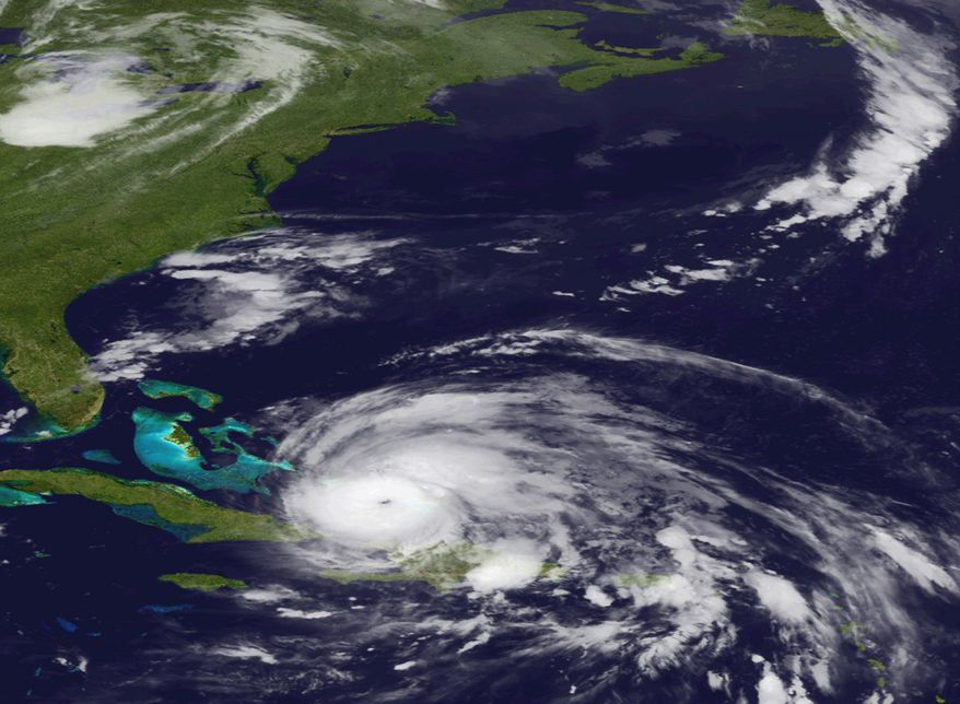 An image released by the National Oceanic and Atmospheric Administration made from the GEOS East satellite shows Hurricane Irene on Wednesday, Aug. 24, 2011, as it moves northwest from the Dominican Republic. (AP Photo/NOAA)