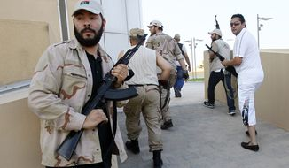 Libyan rebels patrol to try to find any of Moammar Gadhafi's relatives as they heard rumors that one of his sons was hiding inside a building, in Tripoli, Libya, Wednesday, Aug. 24, 2011. (AP Photo/Francois Mori)