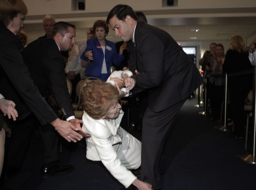 Sen. Marco Rubio (right), Florida Republican, helps former first lady Nancy Reagan as she takes a tumble at the Reagan Forum at the Ronald Reagan Presidential Library and Museum in Simi Valley, Calif., on Tuesday, Aug. 23, 2011. (AP Photo/Jae C. Hong)