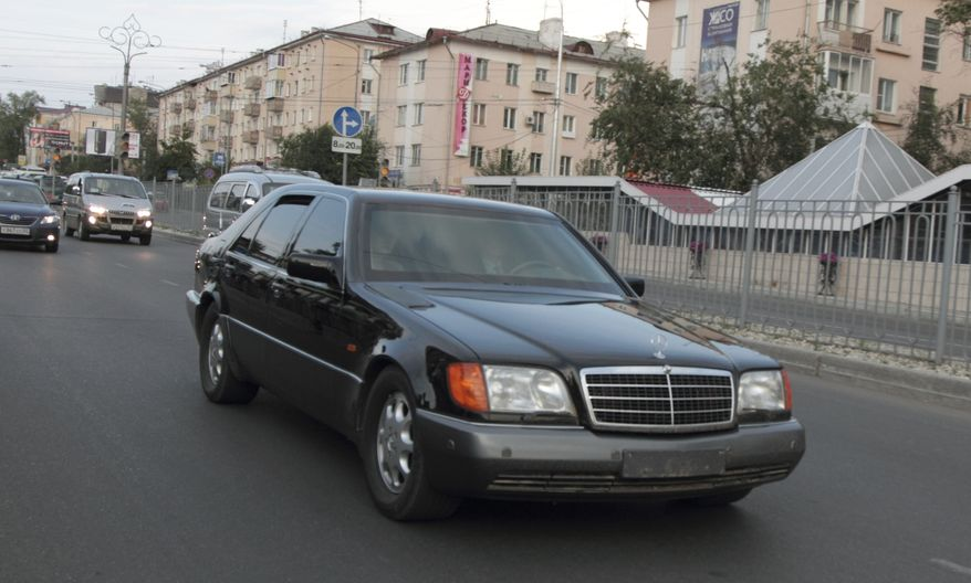 A limousine without license plates reportedly carrying North Korean leader Kim Jong-il is seen in Ulan-Ude, Russia, on Tuesday, Aug. 23, 2011. (AP Photo/Anna Ogorodnik)