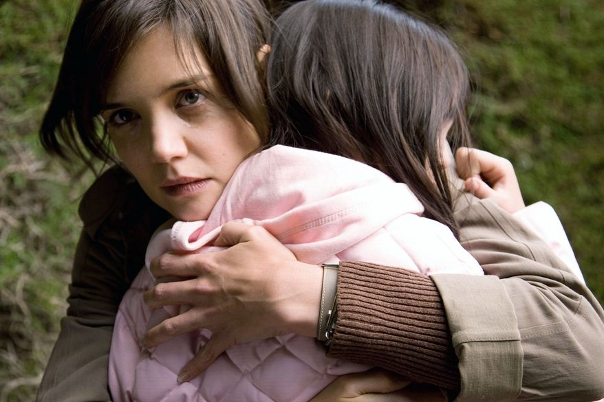 """Kim, portrayed by Katie Holmes (left), and Sally, played by Bailee Madison, set aside their family squabbles to fight hairy fairy monsters in """"Don't Be Afraid of the Dark."""" (Film District via Associated Press)"""