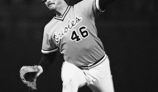Left-hander Mike Flanagan won 167 games over 18 seasons with Baltimore and Toronto, earning the Cy Young Award with the Orioles in 1979 after going 23-9 with a 3.08 ERA. Here, he pitches to a Pittsburgh during the opening game of the '79 World Series. (Associated Press)