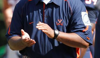 Virginia coach Mike London can continue take away possible Maryland recruits with a win on the road Saturday. (Associated Press)