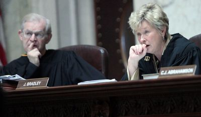 ASSOCIATED PRESS Justices David Prosser and Ann Walsh Bradley work side by side on the Wisconsin Supreme Court, but an altercation in June brought them close to the other side of the legal bench. Justice Walsh Bradley accused Justice Prosser of choking her during deliberations over the state's collective-bargaining law.
