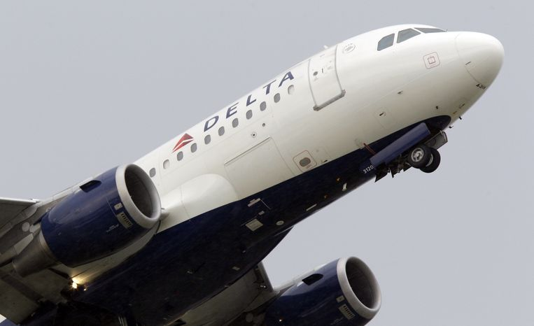 A Delta Air Lines jet takes off from Detroit Metropolitan Wayne County Airport, one of the airline's hubs, in Romulus, Mich., on Friday, July 22, 2011. (AP Photo/Carlos Osorio)