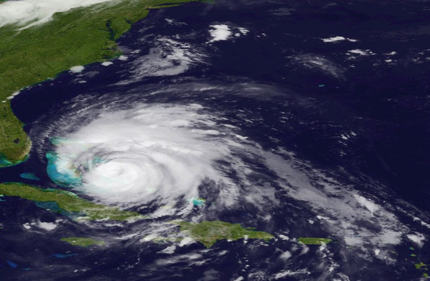 In an image provided by the National Oceanic and Atmospheric Administration and made by the GOES East satellite, Hurricane Irene moves over the Bahamas on Thursday, Aug. 25, 2011. (AP Photo/NOAA)