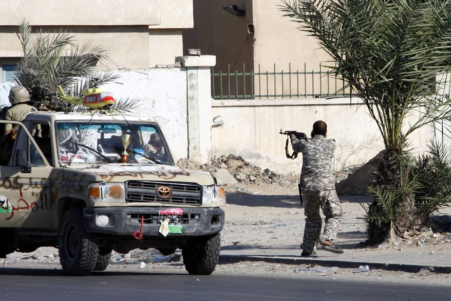A Libyan rebel fires at soldiers loyal to Col. Moammar Gadhafi in Tripoli, Libya, on Aug. 25, 2011. (Associated Press)