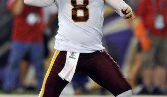 Washington Redskins quarterback Rex Grossman throws during the first half against the Baltimore Ravens on Thursday, Aug. 25. (AP Photo/Gail Burton)