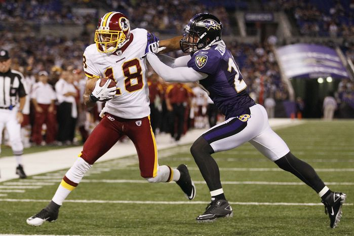 Washington Redskins wide receiver Terrence Austin scores a touchdown under pressure from Baltimore Ravens safety Tom Zbikowski during the second half of an NFL preseason football game in Baltimore, Thursday, Aug. 25, 2011. (AP Photo/Patrick Semansky)