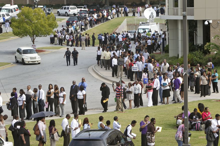 Job seekers wait in line at a 2011 Congressional Black Caucus job fair. President Obama neglected stubbornly high black unemployment, says Raynard Jackson. (AP Photo/Atlanta Journal & Constitution, Bob Andres)