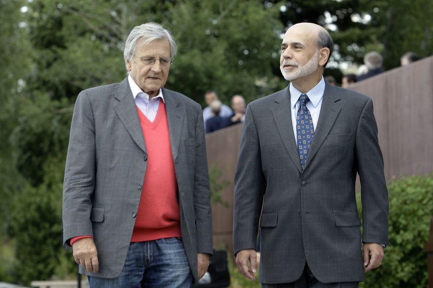 Federal Reserve chairman Paul Bernanke (right) and Jean-Claude Trichet, of France, president of the European Central Bank, take a stroll Aug. 26, 2011, on the veranda of the Jackson Lake Lodge before the morning session of the Economic Policy Symposium at Jackson Hole in Moran, Wyo. (Associated Press)