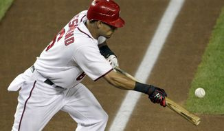 Washington Nationals Ian Desmond pops up his bunt attempt to the catcher for an out during the fifth inning against the Arizona Diamondbacks on Thursday. The Nats lost 8-1. (AP Photo/Pablo Martinez Monsivais)
