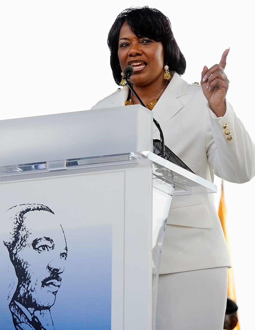 Rev. Bernice King, daughter of the legendary civil rights leader Martin Luther King, Jr., addresses an impromptu gathering at her father's memorial in Washington, Friday August 26, 2011. The memorial's dedication has been postponed due to Hurricane Irene's impending arrival. (AP Photo/Cliff Owen)