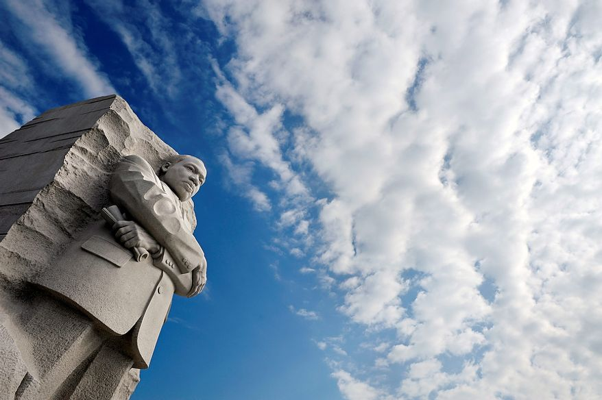 Clouds gather over the Martin Luther King, Jr. Memorial in Washington, Friday, Aug. 26, 2011. The memorial's dedication ceremony has been postponed due to the impending arrival of Hurrican Irene.  (AP Photo/Cliff Owen)