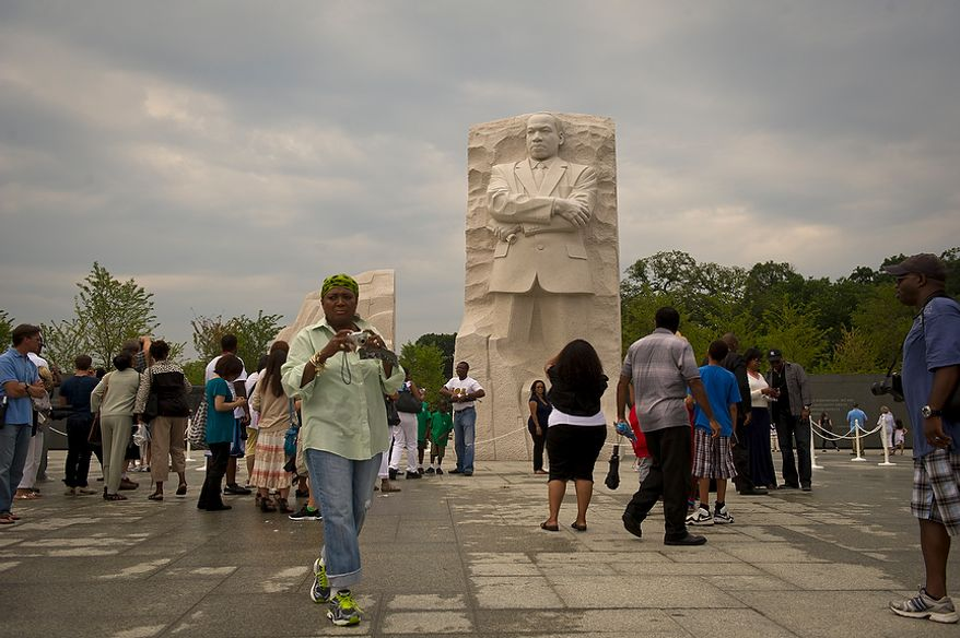 As storm clouds hang in the sky above following a downpour of rain, tourists arrive to visit the newly built Martin Luther KIng Jr. National Memorial in Washington, D.C., Thursday, August 25, 2011. Though a lot of rain fell today, this storm is not believed to be connected to the approaching Hurricane Irene. (Rod Lamkey Jr./The Washington Times)