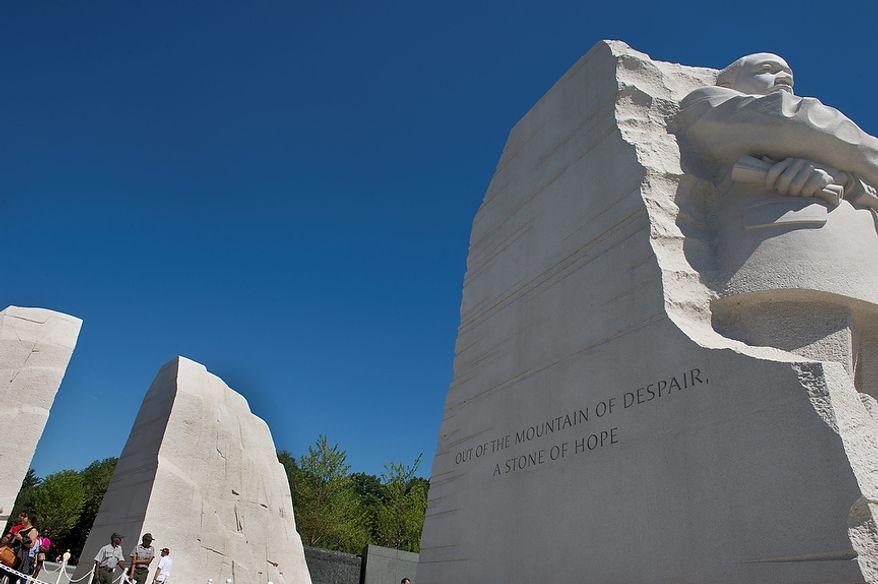 """Visitors walk through the large stone mountain """"gates"""" to enter the Martin Luther King Jr. Memorial in Washington on Monday, Aug. 22, 2011. (Barbara L. Salisbury/The Washington Times)"""