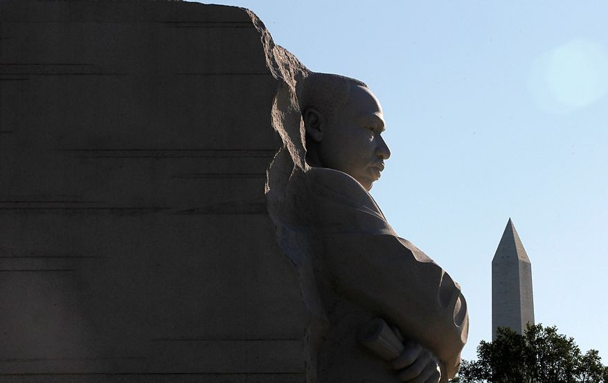 The Washington Monument is pictured at right as a detail of the Martin Luther King Jr. Memorial is seen ahead of its originally scheduled August dedication in Washington. (AP Photo/Charles Dharapak)