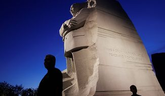 The Martin Luther King Jr. Memorial is seen at dusk ahead in Washington on Monday, Aug. 22, 2011. (AP Photo/Charles Dharapak)