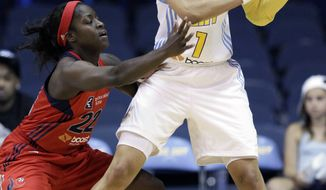 Chicago Sky's Tamera Young, right, looks to a pass as Washington Mystics' Matee Ajavon guards during the first quarter Friday, Aug. 26, 2011, in Rosemont, Ill. (AP Photo/Nam Y. Huh)