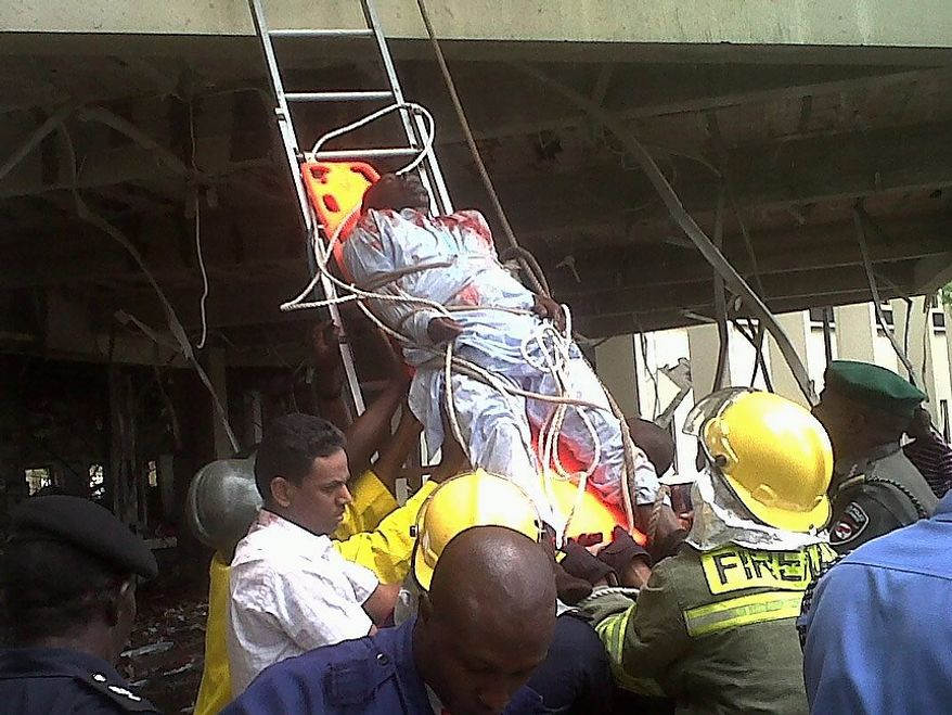This image released by Saharareporters shows an injured man being stretchered down a ladder by firefighters after a large explosion struck the United Nations' main office in Nigeria's capital Abuja Friday Aug. 26, 2011, flattening one wing of the building and killing several people. A U.N. official in Geneva called it a bomb attack. The building, located in the same neighborhood as the U.S. embassy and other diplomatic posts in Abuja, had a huge hole punched in it.   (AP Photo/Saharareporters)