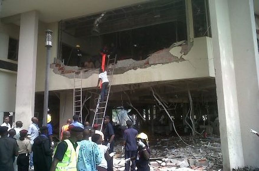 This image released by Saharareporters shows firefighters and rescue workers after a large explosion struck the United Nations' main office in Nigeria's capital Abuja Friday Aug. 26, 2011, flattening one wing of the building and killing several people. A U.N. official in Geneva called it a bomb attack. The building, located in the same neighborhood as the U.S. embassy and other diplomatic posts in Abuja, had a huge hole punched in it.   (AP Photo/Saharareporters)