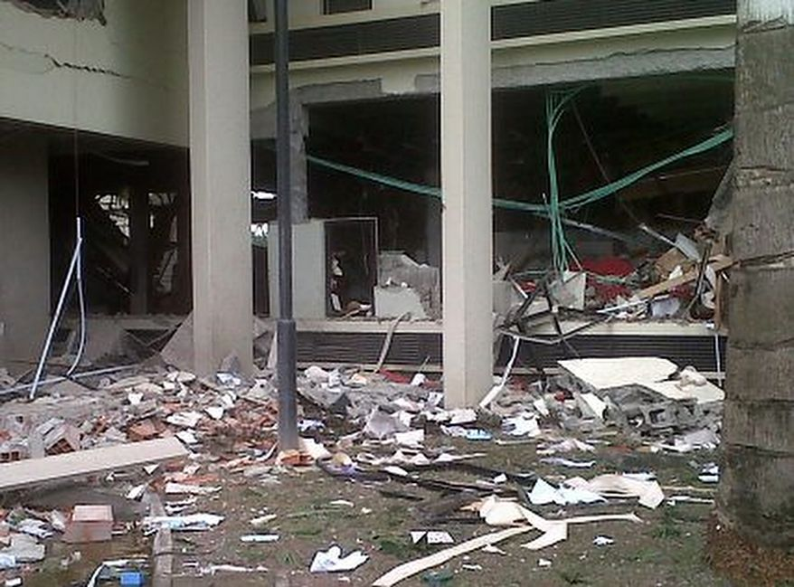 This image released by Saharareporters shows debris after a large explosion struck the United Nations' main office in Nigeria's capital Abuja Friday Aug. 26, 2011, flattening one wing of the building and killing several people. A U.N. official in Geneva called it a bomb attack. The building, located in the same neighborhood as the U.S. embassy and other diplomatic posts in Abuja, had a huge hole punched in it.   (AP Photo/Saharareporters)