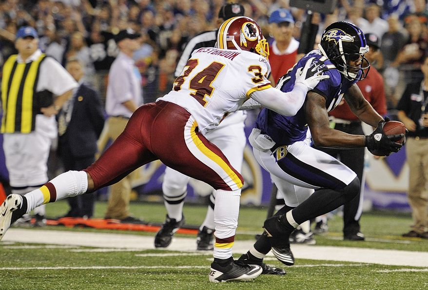 Baltimore Ravens wide receiver Brandon Jones is pursued by Washington Redskins cornerback Byron Westbrook as he carries the ball in for a touchdown during the second half.The Ravens defeated the Redskins 34-31. (AP Photo/Nick Wass)