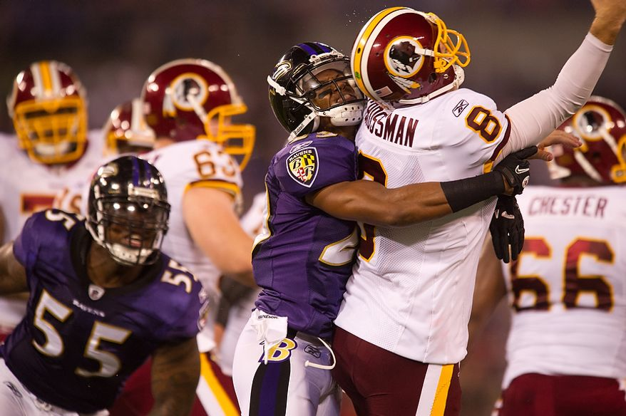 Quarterback Rex Grossman of the Washington Redskins is hit while throwing by Cary Williams of the Baltimore Ravens in preseason football at M&T Bank Stadium in Baltimore, MD, Thursday, August 25, 2011. (Andrew Harnik / The Washington Times)