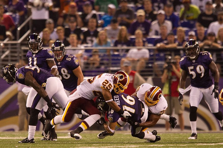 Evan Royster, left, and Darrel Young of the Washington Redskins tackle Brandon Banks of the Baltimore Ravens in in the first quarter of preseason football at M&T Bank Stadium in Baltimore, MD, Thursday, August 25, 2011. (Andrew Harnik / The Washington Times)