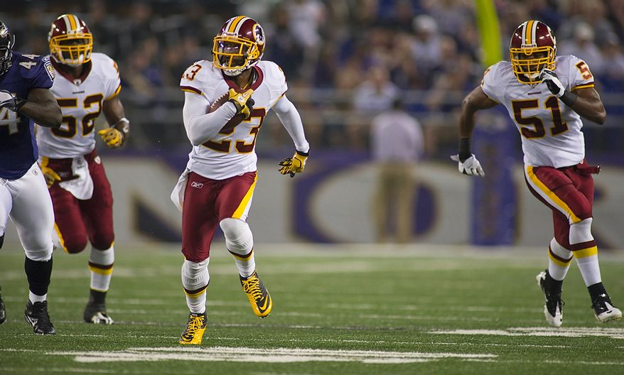 DeAngelo Hall of the Washington Redskins (23) runs back an interception for a touchdown in the first quarter at M & T Bank Stadium in Baltimore, Md, Thursday, August 25, 2011. (Rod Lamkey Jr./The Washington Times)