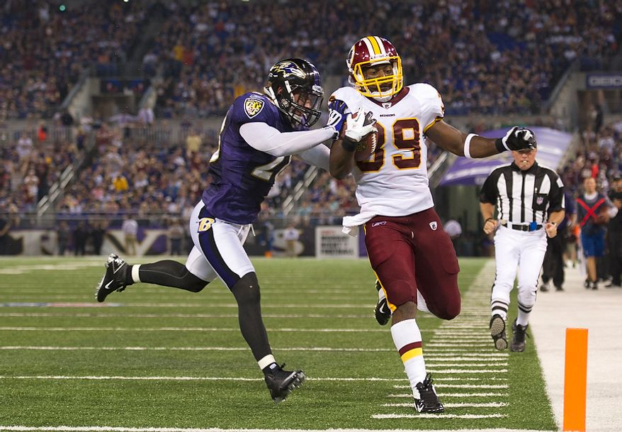 Dante Barnes of the Washington Redskins (39) scores a touchdown while being defended against by Tom Zbikowski (28) of the Baltimore Ravens in the first quarter at M & T Bank Stadium in Baltimore, Md, Thursday, August 25, 2011. (Rod Lamkey Jr./The Washington Times)