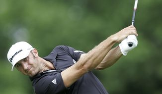Dustin Johnson hits his tee shot on the 12th hole during the final round of The Barclays golf tournament Saturday, Aug. 27, 2011, in Edison, N.J. (AP Photo/Rich Schultz)