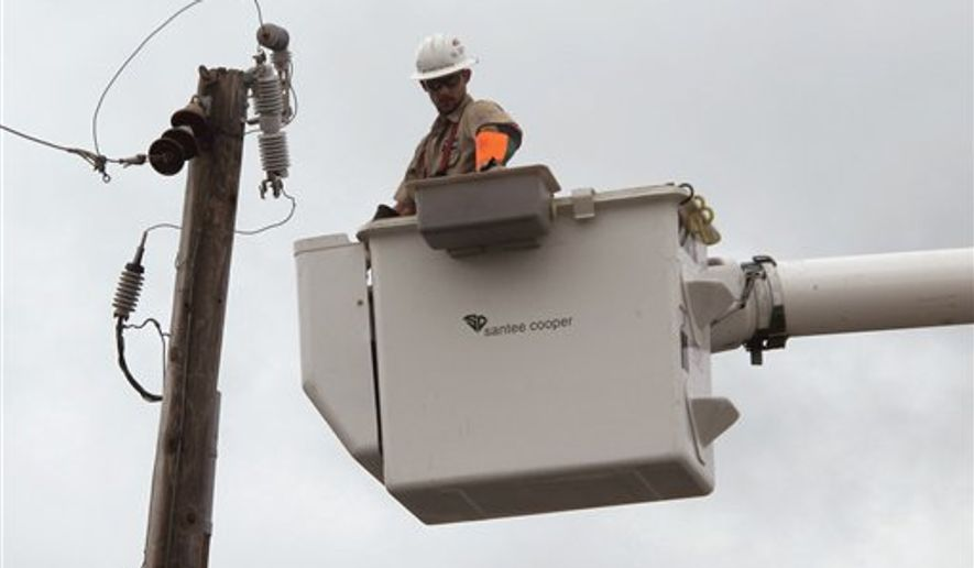 A worker for Santee Cooper, South Carolina's state-owned utility, repairs a power line downed by Hurricane Irene in North Myrtle Beach, S.C., on Saturday, Aug. 27, 2011. An estimated 8,000 electric customers in South Carolina lost power because of the storm. (AP Photo/Bruce Smith)