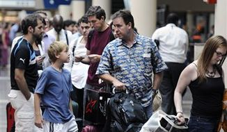 Travelers wait in line to board Amtrak's Northeast Regional train to Boston at Union Station in Washington, Friday, Aug. 26, 2011. (AP Photo/Cliff Owen)