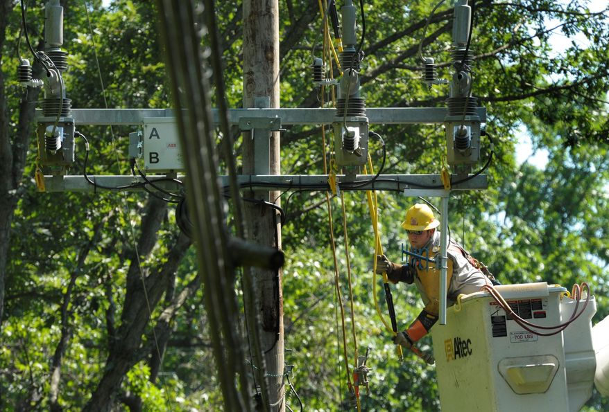 Baltimore Gas and Electric contractor Nate Mickel, of Altoona, Pa., works on a damaged power line in Annapolis on Sunday. Power companies spent much of last week planning for Hurricane Irene, calling in hundreds of extra personnel. (Associated Press)