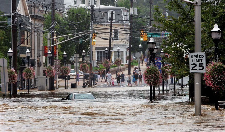 ASSOCIATED PRESS A car is submerged by floodwater Sunday in Hightstown, N.J., after Hurricane Irene caused Peddie Lake to overflow. Flooding problems erupted across New Jersey as the storm passed and caused multiple road closures.