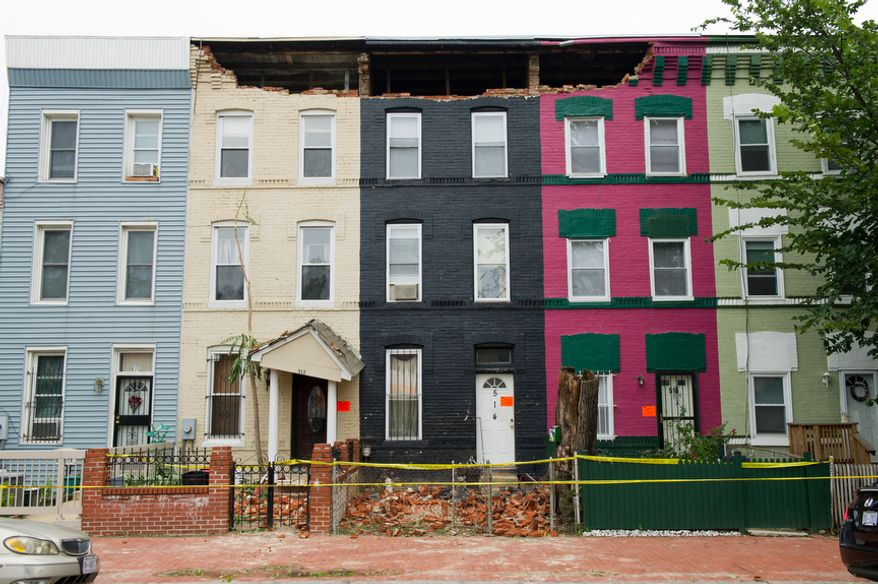 Hurricane Irene, which passed through the D.C. region on Saturday and early Sunday, damaged three row houses near Sixth and R streets NW in Washington. (Andrew Harnik/The Washington Times)
