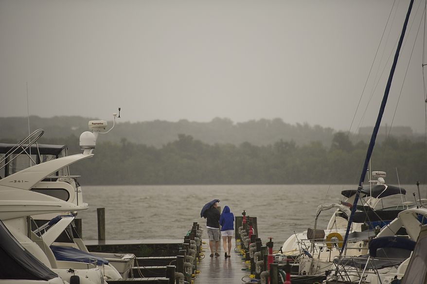 As Hurricane Irene makes her way up the Atlantic coast, a couple walks out to the pier at the waterfront  in Alexandria, Va, Saturday, August 27, 2011. (Rod Lamkey Jr./The Washington Times)