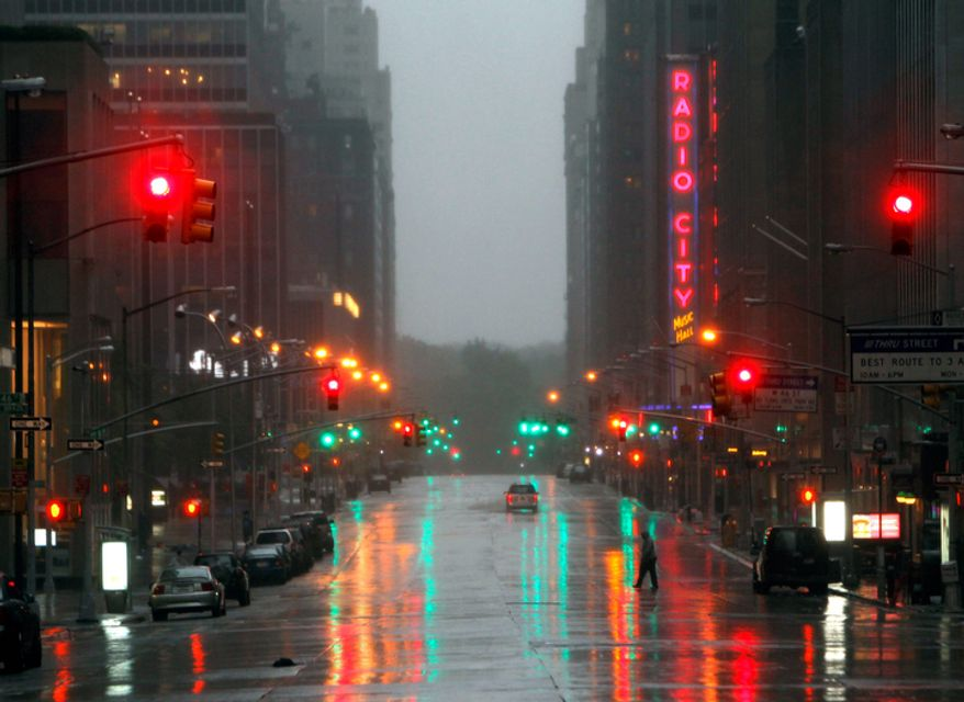 Sixth Avenue near Radio City Music Hall is empty as Tropical Storm Irene hits in New York, on Sunday, Aug. 28, 2011.  (AP Photo/Mike Groll)