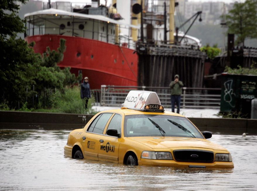 A New York City taxi is stranded in deep water on Manhattan's West Side as Tropical Storm Irene passes through the city, Sunday, Aug. 28, 2011 in New York.  (AP Photo/Peter Morgan)