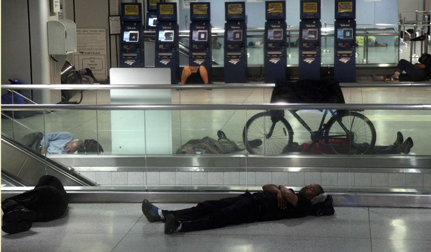 People sleep at Penn Station in New York, early Sunday, Aug. 28, 2011. Public transportation in New York shut down around noon on Saturday. (AP Photo/Chelsea Matiash)