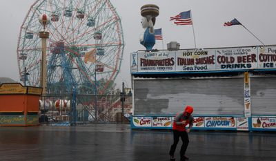 NBC reporter Peter Alexander attempts to broadcast from the windswept Coney Island boardwalk in New York as Hurricane Irene became intensified Sunday, Aug. 28 2011 in Coney Island section of  New York. (AP Photo/Craig Ruttle