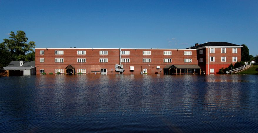 A building is flooded by water that rose above the banks of the St. Jones River in Dover, Del., Sunday, Aug. 28, 2011, after Hurricane Irene dumped several inches of rain along the Delaware coast overnight.  (AP Photo/Patrick Semansky)